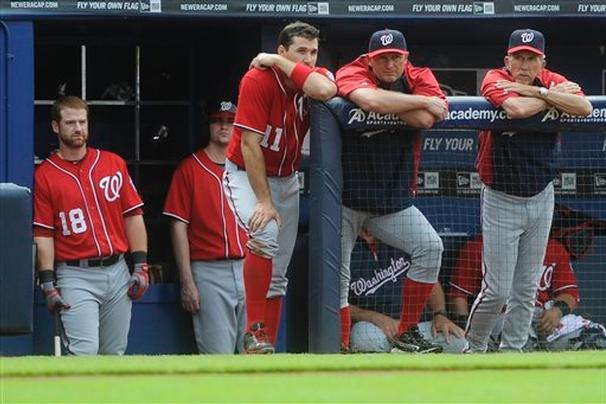 There's no joy in Mudville – nor in the Nationals' dugout. Chad Tracy (18), Ryan Zimmerman (11), Rick Eckstein, and manager Davey Johnson, right, watch the final moments of the game against the Braves, Sunday, in Atlanta. (AP Photo/John Amis)